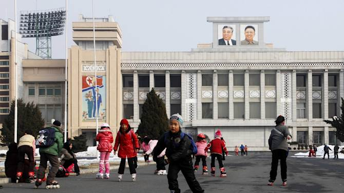 North Korean children accompanied by their grand parents, roller-skate at Kim Il Sung stadium in Pyongyang, North Korea, Wednesday, Feb. 13, 2013. One day earlier, North Korea conducted an underground nuclear test in the far north of the country, its third since 2006. (AP Photo/Jon Chol Jin)
