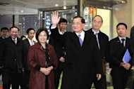 Taiwan's former vice-president Lien Chan (C) waves as he arrives at a hotel in Beijing on February 24, 2013. The Taiwan politician known for making a landmark 2005 visit to China flew to Beijing February 24 to meet China's Communist Party chief Xi Jinping in the highest level cross-strait meeting since Xi took office, officials said