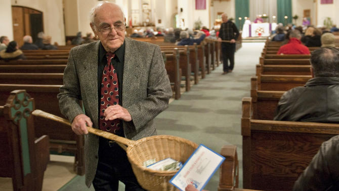 John Alves, of Dartmouth, Mass., uses a basket while taking collection