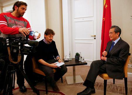 China's Foreign Minister Wang answers reporter's questions during a Reuters interview in Munich