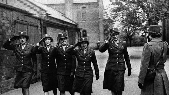 FILE - In this May 5, 1944 file photo, five members of the Women's Army Corps serving with the army service of supplies, salute an officer at a base in England. (AP Photo, File)