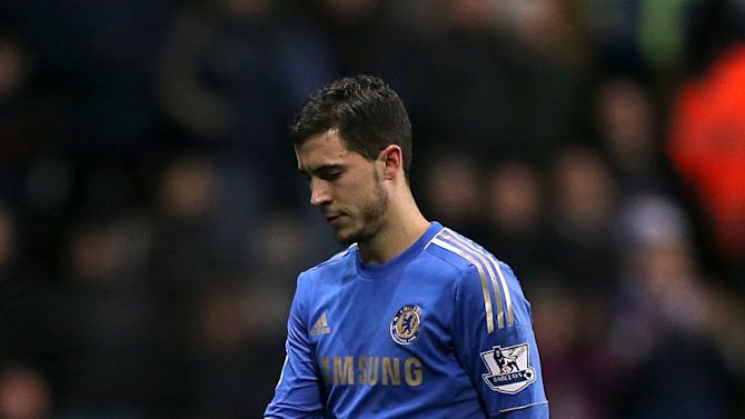 Chelsea's Eden Hazard walks off the field of play dejected after he receives a red card for violent conduct during the English League Cup second leg semi-final soccer match between Chelsea and Swansea City at the Liberty Stadium, Swansea, Wales, Wednesday Jan. 23, 2013. Hazard was involved in an incident with a ball boy.(AP Photo/PA, Nick Potts) UNITED KINGDOM OUT  NO SALES  NO ARCHIVE