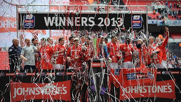 Crewe Alexandra players celebrate winning the Johnstone's Paint Trophy final