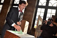 Prime Minister Elio Di Rupo casts a vote at a polling station in Mons during the Belgian municipal and provincial elections. Flemish nationalist leader Bart De Wever scored a breakthrough election win Sunday and immediately urged Di Rupo to radically re-shape the federal state