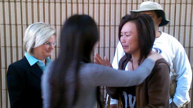 FILE - In this May 22, 2012 file photo Bei Bei Shuai, 35, right, Indianapolis, hugs her friend, Sue Mak, second left, as attorney Linda Pence, left, looks on after Shuai's release on bail from the Marion County Jail in Indianapolis. A judge on Wednesday, Jan. 23, 2013 ruled that a medical examiner's conclusion that a newborn baby's death was caused by the rat poison her mother, Bei Bei Shuai, ate while she was pregnant is unreliable and cannot be used at the woman's murder trial. (AP Photo/Charles D. Wilson, File)