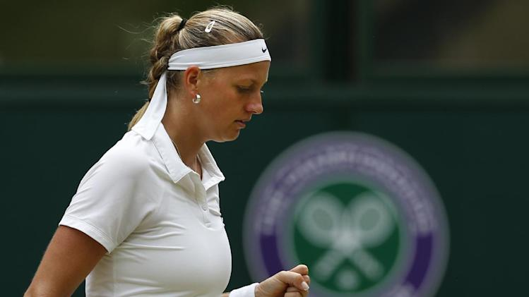Petra Kvitova of the Czech Republic celebrates winning a point against Eugenie Bouchard of Canada during the women's singles final at the All England Lawn Tennis Championships in Wimbledon, London, Saturday July 5, 2014