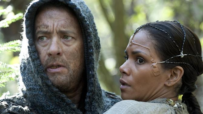 "This film image released by Warner Bros. Pictures shows Tom Hanks as Zachry and Halle Berry as Meronym in a scene from ""Cloud Atlas,"" an epic spanning centuries and genres. The film is an epic of shifting genres and intersecting souls that features Tom Hanks, Halle Berry, Jim Broadbent, Hugh Grant, Hugo Weaving, Ben Whishaw, Jim Sturgess, James D'Arcy, Doona Bae, Keith David, Sarandon and others in multiple roles spanning the centuries. (AP Photo/Warner Bros. Pictures, Jay Maidment)"