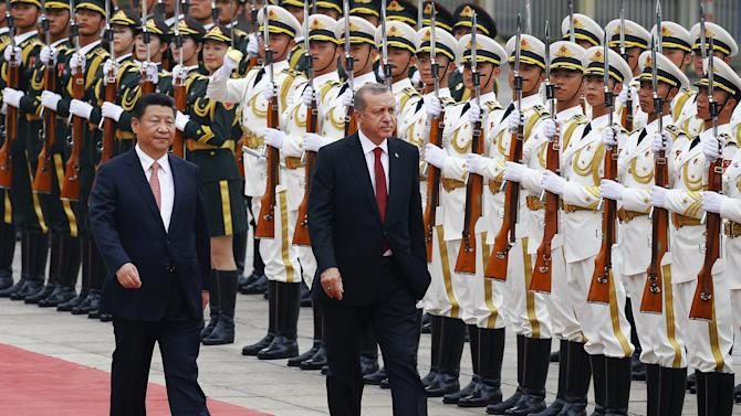 Turkey's President Erdogan and his Chinese counterpart Xi inspect honour guards during a welcoming ceremony outside the Great Hall of the People in Beijing