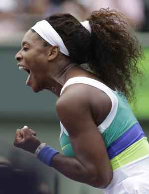 Serena Williams reacts after winning a point against Dominika Cibulkova, of Slovakia, during the Sony Open tennis tournament, Monday, March 25, 2013, in Key Biscayne, Fla. (AP Photo/Lynne Sladky)