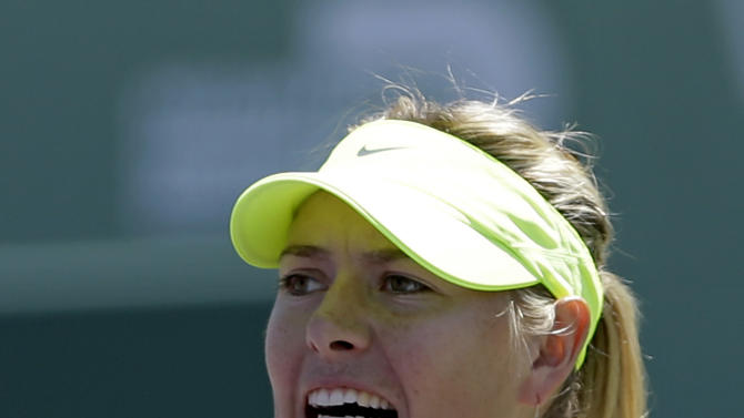 Maria Sharapova, of Russia, celebrates after winning a point against Jelena Jankovic, of Serbia, during the semifinals of the Sony Open tennis tournament in Key Biscayne, Fla., Thursday, March 28, 2013. Sharapova won 6-2, 6-1. (AP Photo/Alan Diaz)