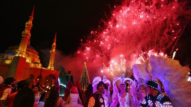 Fireworks explode during a Christmas tree lighting in downtown Beirut