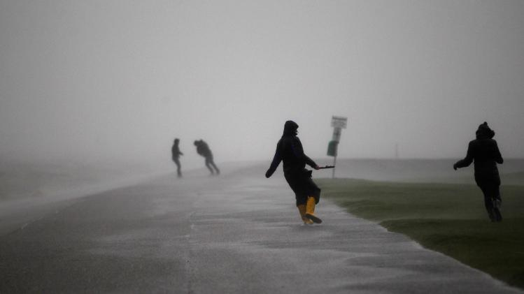 People walk on the North Sea beach near the town of Norddeich
