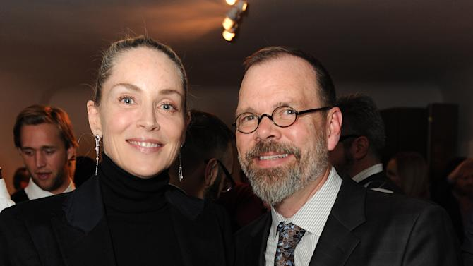 """Sharon Stone and David France attend LoveGold/EJAF Celebrate """"How to Survive a Plague"""" at Chateau Marmont on February 22, 2013 in Los Angeles. (Photo by Jordan Strauss/Invision for LoveGold/AP Images)"""