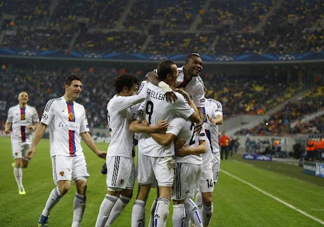 Basel team players celebrate Marcelo Diaz's goal against Steaua during the UEFA Champions League group E soccer match between Steaua Bucharest and FC Basel, in Bucharest, Romania, on Tuesday, Oct. 22,
