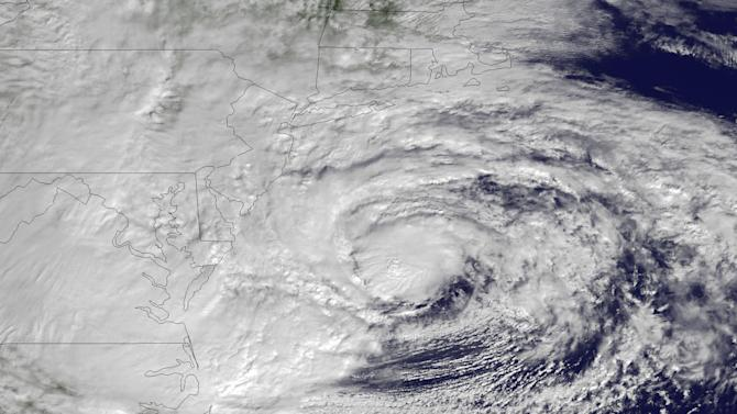 FILE - In this October 2012 satellite photo provided by NOAA, Hurricane Sandy swirls off the Mid-Atlantic coastline moving toward the north with maximum sustained winds of 90 mph. Researchers at the University of Utah reported Thursday, April 18, 2013, that energy from Superstorm Sandy was detected by a network of earthquake sensors around the country. Seismometers normally measure quakes, but can also detect energy released by storms, tornadoes and mine collapses. (AP Photo/NOAA, File)