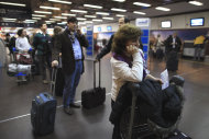 People line up at Aerolineas Argentinas airline desk to reschedule their flights at the Jorge Newbery Airport, after their flights were cancelled due to an ash cloud that reached Buenos Aires from Chile's Peyuhue volcano, grounding most air travel in Buenos Aires, Argentina, Tuesday June 7, 2011. The wind carried volcanic ash across the Andes to Argentina resulting in the closing of six airports, and the cancellation of flights in the capital city. The Puyehue volcano, dormant for decades, erupted in south-central Chile on Saturday. (AP Photo/Natacha Pisarenko)