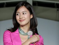FILE - In this May 26, 2005 file photo, South Korean actress Kim Tae-hee participates in a fashion show held by South Korean apparel maker Shinwon company in the inter-Korean industrial park in Kaesong, just a few hundred meters (yards) north of the heavily fortified Demilitarised Zone that divides the Korean peninsula. South Korean pop star Rain is facing questions after paparazzi photos showed him out on the town with Kim. Seoul's Defense Ministry said Wednesday, Jan. 2, 2013 it is investigating whether Rain broke military rules by meeting the actress while on duty. (AP Photo/Lee Jae-Won, Pool, File)
