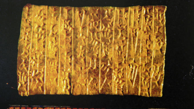 """FILE - In A handout photocopy from court records shows the 3,200-year-old gold tablet at the center of a court case between a Holocaust survivor's family and a Berlin museum in Albany, N.Y. In a ruling rejecting any claims to the """"spoils of war,"""" New York's highest court concluded Thursday, Nov. 14, 2013, that an ancient gold tablet must be returned to the German museum that lost it in World War II. The Court of Appeals unanimously agreed that Riven Flamenbaum's estate is not entitled to the 3,000-year-old Assyrian relic, a 9.5-gram (.34-ounce) tablet nearly the size of a credit card. (AP Photo/New York State Court of Appeals)"""