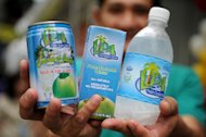 This photo taken on August 30, 2012 shows a vendor displaying coconut-water products in Manila. After centuries of replenishing Filipinos, the mineral-rich liquid has become a must-have health drink thanks to aggressive marketing by a beverage industry looking to offset soda sales that have lost their fizz