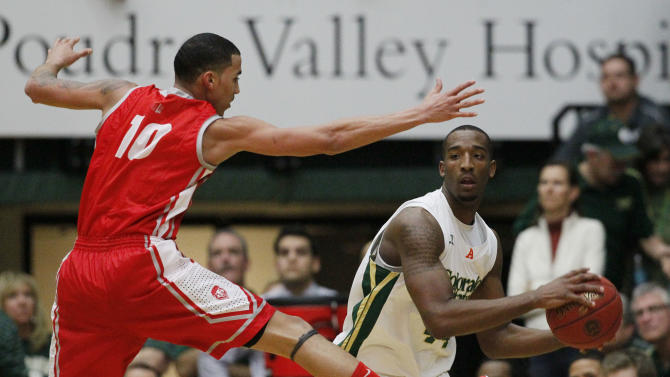 New Mexico guard Kendall Williams, left, takes to the air to block a pass by Colorado State forward Greg Smith in the second half of New Mexico's 91-82 victory in an NCAA basketball game in Fort Collins, Colo., on Saturday, Feb. 23, 2013. (AP Photo/David Zalubowski)