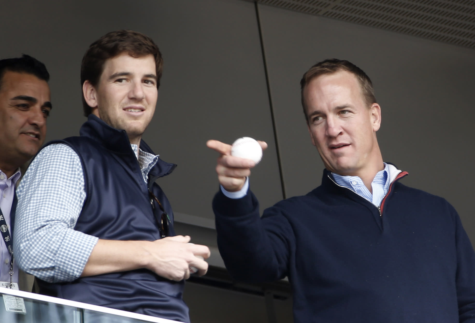 Peyton Manning has a little fun with little brother Eli