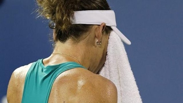 Samantha Stosur, of Australia, wipes her face prior to facing Victoria Duval, of the United States, for match point in the first round of the 2013 U.S. Open tennis tournament, Tuesday, Aug. 27, 2013, in New York. Duval won 5-7, 6-4, 6-4.