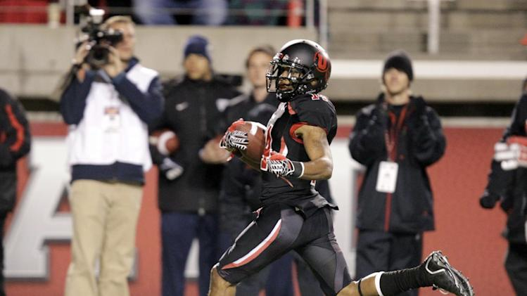Utah wide receiver Reggie Dunn (14) returns a 100 yd kickoff return in the fourth quarter during an NCAA college football game with California Saturday, Oct. 27, 2012, in Salt Lake City.  Utah defeated California  49-27. (AP Photo/Rick Bowmer)