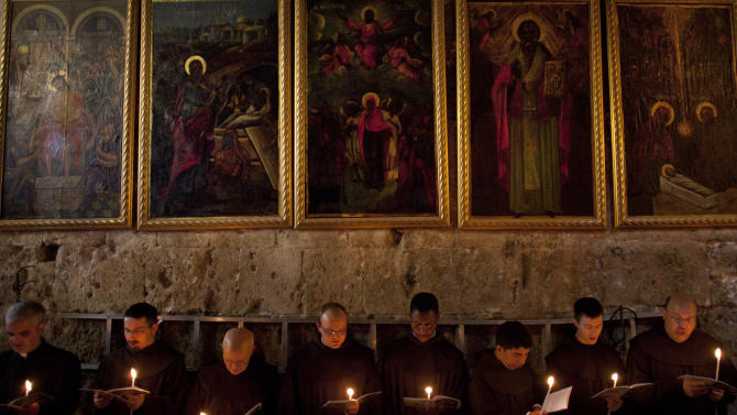Catholic clergy attend a procession during Holy Saturday inside the Church of the Holy Sepulchre, traditionally believed to be the burial site of Jesus Christ, Saturday, April 7, 2012. (AP Photo/Bernat Armangue)