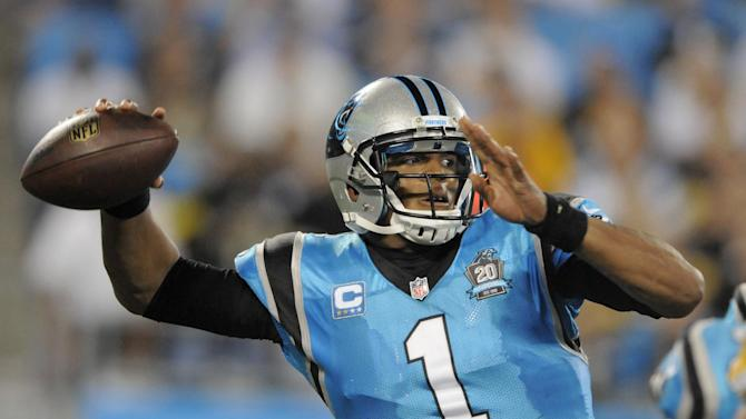 Carolina Panthers' Cam Newton looks to pass against the Pittsburgh Steelers during the second half of an NFL football game in Charlotte, N.C., Sunday, Sept. 21, 2014