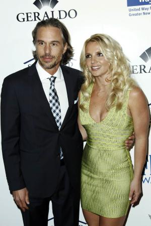 """FILE - In this May 11, 2011 file photo, singer Britney Spears, right, and Jason Trawick arrive at an Evening of """"Southern Style"""" in Beverly Hills, Calif. Spears has requested a judge appoint her fiance, Trawick, as a co-conservator and help oversee her personal affairs along with her father, according to reports Monday, April 9, 2012. (AP Photo/Matt Sayles, File)"""