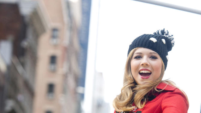 Jennette McCurdy rides a float in the Macy's Thanksgiving Day Parade in New York, Thursday, Nov. 22, 2012. The American harvest holiday came as portions of the Northeast were still coping with the wake of Superstorm Sandy, and volunteers planned to serve thousands of turkey dinners to people it left homeless or struggling. (AP Photo/Charles Sykes)