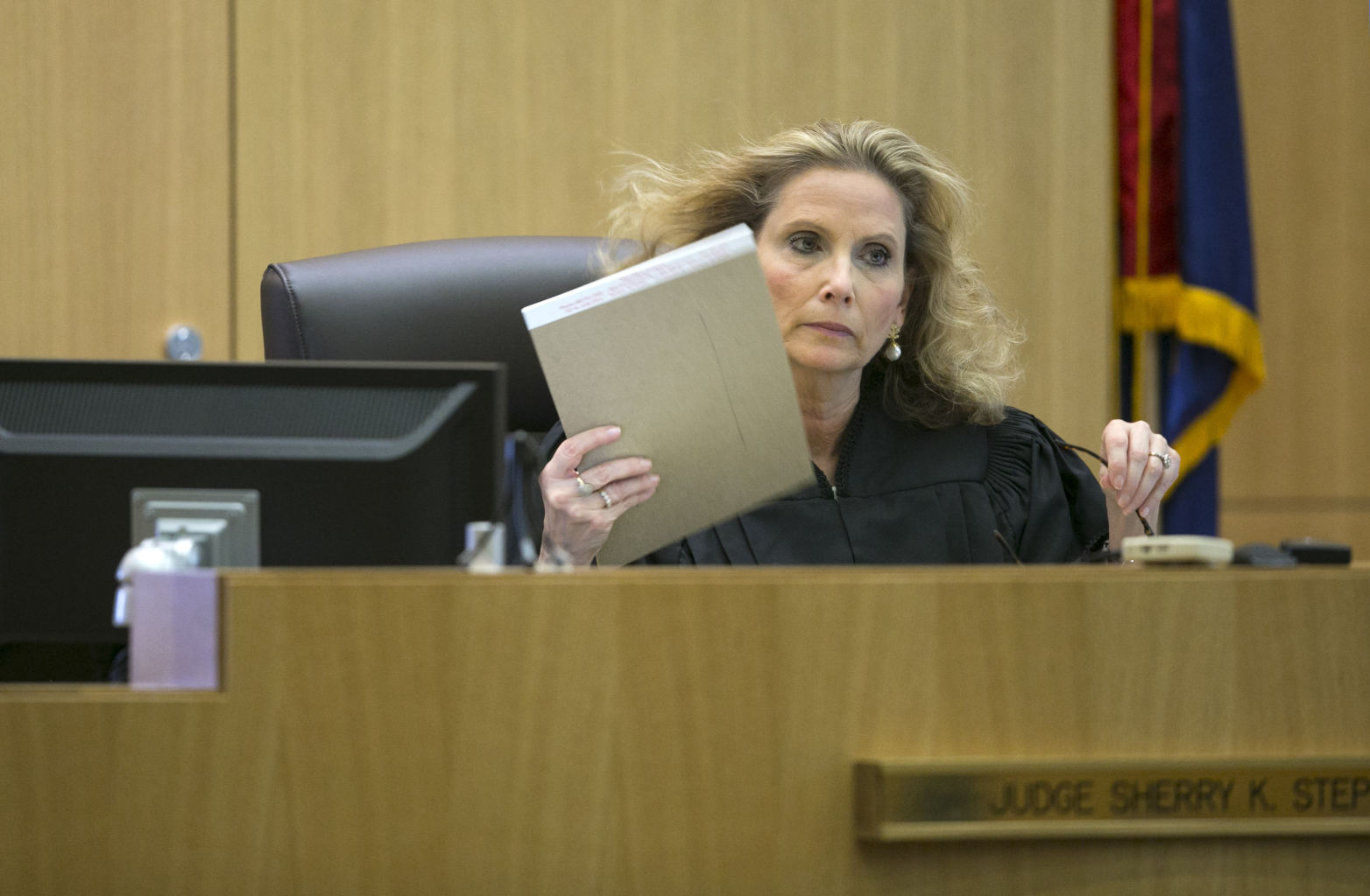 with a stack of papers during the sentencing phase of Jodi Arias ...