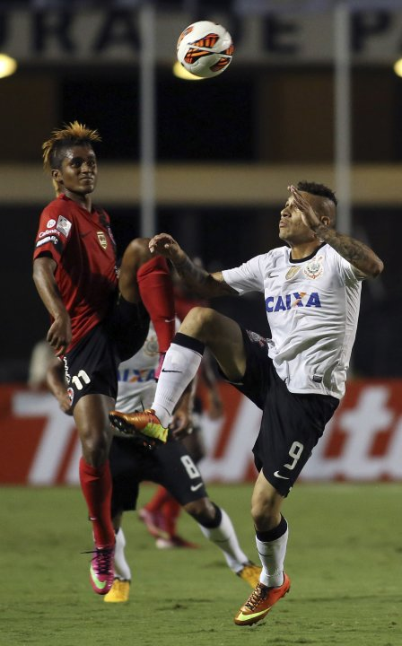 Guerrero of Brazil's Corinthians challenges Tenorio of Mexico's Tijuana during their Copa Libertadores soccer match in Sao Paulo
