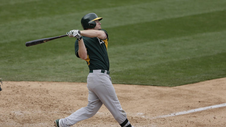 Oakland Athletics' Chris Gimenez hits a foul ball while batting against the Arizona Diamondbacks during the seventh inning of an exhibition spring training baseball game Thursday, March 6, 2014, in Scottsdale, Ariz. (AP Photo/Gregory Bull)