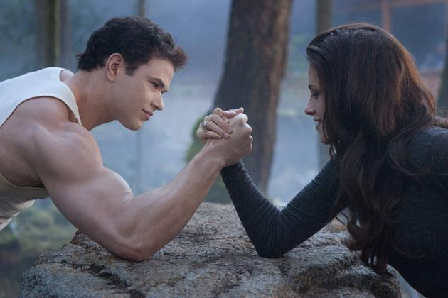 Twilight Sexiest Moments: Bella and Emmett flex their muscles in the famous arm wrestling scene in Breaking Dawn Part 2.