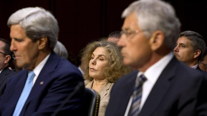 Teresa Heinz Kerry, center, wife of Secretary of State John Kerry, left, listens on Capitol Hill in Washington, Tuesday, Sept. 3, 2013, during a Senate Foreign Relations Committee hearing on Syria , as her husband, Defense Secretary Chuck Hagel, right, and Joint Chiefs Chairman General Martin E. Dempsey, not pictured, testified. Teresa Heinz Kerry, the wife of Secretary of State John Kerry, made her first public appearance since suffering a seizure in July. (AP Photo/Jacquelyn Martin)