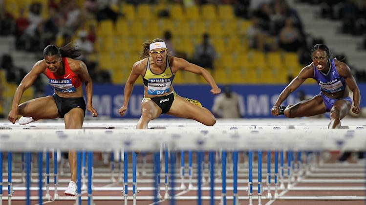 (L-R) Virginia Powell-Crawford, Lolo Jones and Danielle Carruthers of the US compete in the women's 100m hurdles at the IAAF Diamond League in Doha on May 6, 2011. AFP PHOTO/KARIM JAAFAR (Photo credit should read KARIM JAAFAR/AFP/Getty Images)