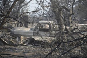 A view of a burnt vehicle after homes were destroyed during the Mountain Fire near Idyllwild,