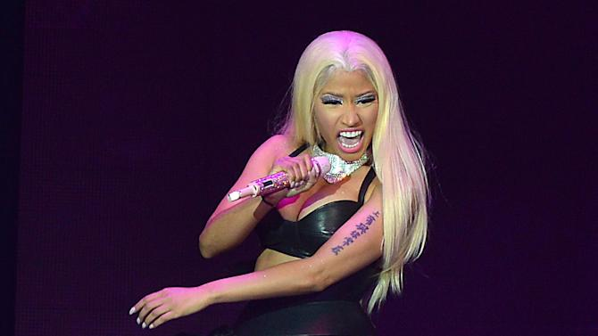 FILE - This Oct. 30, 2012 file photo shows Nicki Minaj performing at the O2  in London. Minaj and her mentor, Lil Wayne, will join forces for a performance at the Billboard Music Awards, to be presented in Las Vegas on May 19. Billboard announced additional performers Thursday. They include Chris Brown, Jennifer Lopez, Ed Sheeran, David Guetta, Akon, Ne-Yo and Icona Pop.  (Photo by Mark Allan/Invision/AP, file)