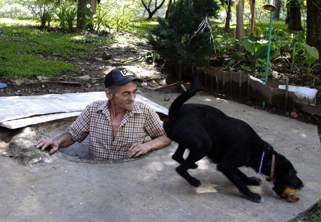 Restrepo plays with his dog …