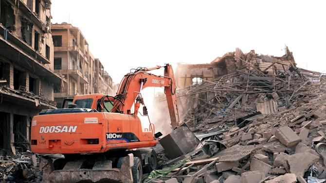 In this photo released by the Syrian official news agency SANA, a bulldozer removes the wreckage of a destroyed buildings where triple bombs exploded at the Saadallah al-Jabri square, in Aleppo city, Syria, Wednesday Oct. 3, 2012. Three powerful explosions rocked the main square in a government-controlled central district of Aleppo on Wednesday, the Syrian state-run TV said. Activists reported multiple casualties and heavy material damage. (AP Photo/SANA)