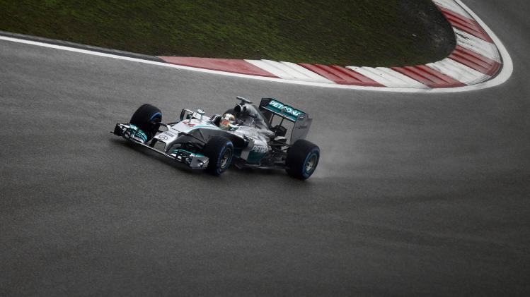 Mercedes Formula One driver Hamilton drives during the qualifying session of the Chinese F1 Grand Prix at the Shanghai International circuit
