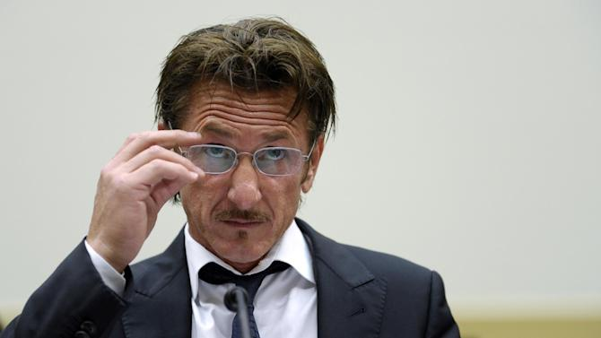 "Academy Award-winning actor Sean Penn waits to testify on Capitol Hill in Washington, Monday, May 20, 2013, before the House subcommittee on Africa, Global Health, Global Human Rights, and International Organizations hearing on Advocating for American Jacob Ostreichers Freedom after two years in Bolivian detention. Ostreicher was arrested in June 2011 by Bolivian police after it was alleged that he did business with ""people wanted in their countries because of links with drug trafficking and money laundering.""  (AP Photo/Susan Walsh)"