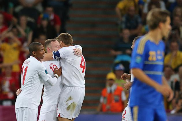 English Forward Wayne Rooney (2L) Celebrates AFP/Getty Images