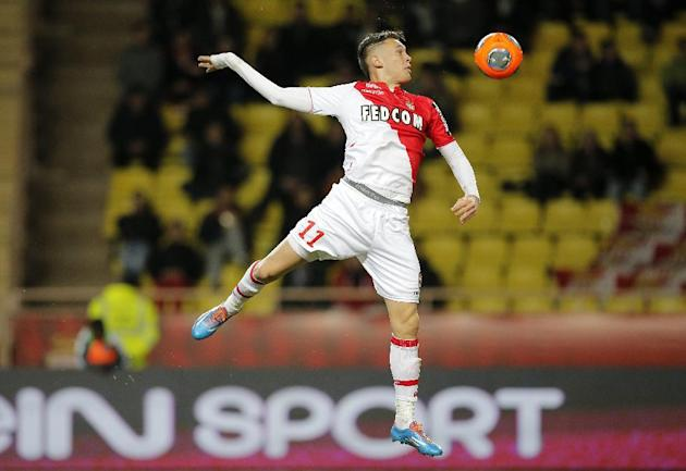 Monaco's Lucas Ocampos of Argentina jumps for the ball during his French League One soccer match against Ajaccio, in Monaco stadium, Sunday, Dec. 8, 2013