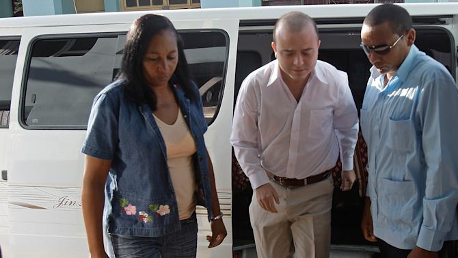 Cuban security forces escort Spanish citizen Angel Carromero, center, to a courthouse to attend a trial in Bayamo, Cuba, Friday Oct. 5, 2012. Carromero went on trial Friday in connection with a car crash in which a prominent dissident Oswaldo Paya and another dissident, Harold Cepero, were killed. (AP Photo/Franklin Reyes)