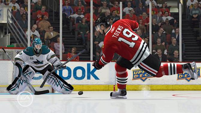 "This video game image released by EA Sports shows the San Jose Sharks battle the Chicago Blackhawks in a scene from ""NHL 13."" (AP Photo/EA Sports)"