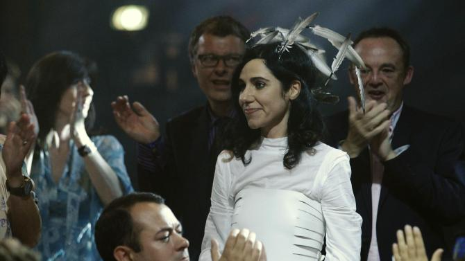 File photo of PJ Harvey being applauded as she prepares to receive the 2011 Mercury Prize in London