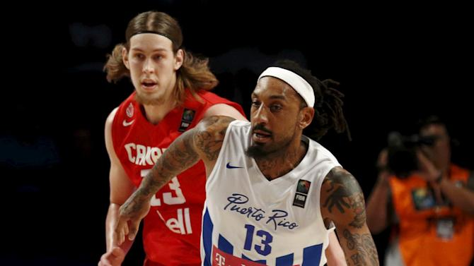 Puerto Rico's Renaldo Balkman dribbles the ball past Canada's Kelly Olynyk during their 2015 FIBA Americas Championship basketball game, in Mexico City