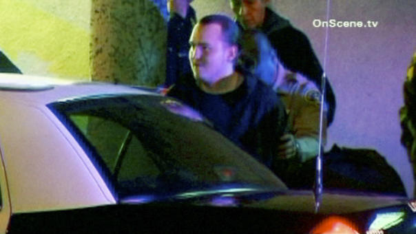 RE-TRANS WITH CORRECTED ASPECT RATIO - In this image taken from video released on Jan. 2, 2012 by OnScene.tv, arson suspect HarryBurkhart, 24, a German national, is arrested in the Hollywood section of Los Angeles. Burkhart was pulled over by a reserve sheriff's deputy and later booked for investigation of arson of an inhabited dwelling. Since the arrest, firefighters have not responded to any other suspicious fires. Police declined to reveal any motive for more than 50 fires that have occurred since Friday in Hollywood, neighboring West Hollywood and the San Fernando Valley, causing about $3 million in damage. (AP Photo/OnScene.tv)